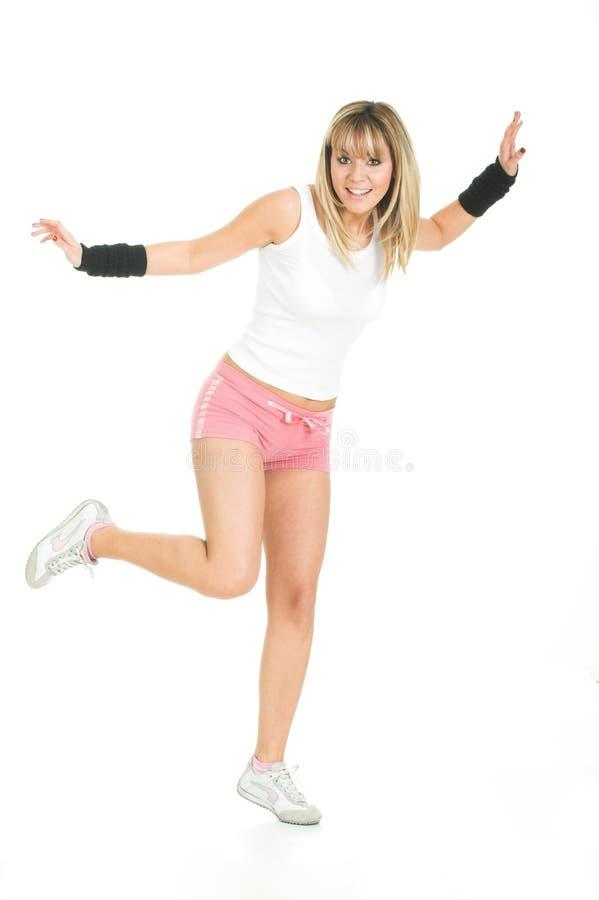 平衡的美丽的姿势妇女 免版税库存照片
