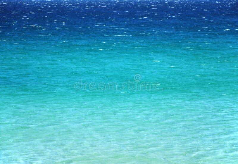 平静天蓝色的海运的表面 免版税图库摄影