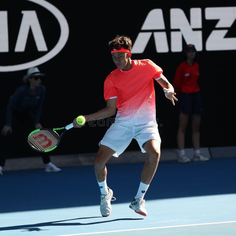 2019年美国的澳网决赛选手埃米利奥纳瓦山口行动的在他的男孩的期间在墨尔本公园选拔决赛 免版税库存图片