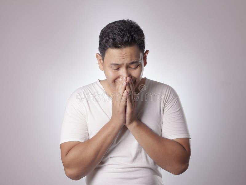 年轻亚洲人哭泣 免版税库存图片