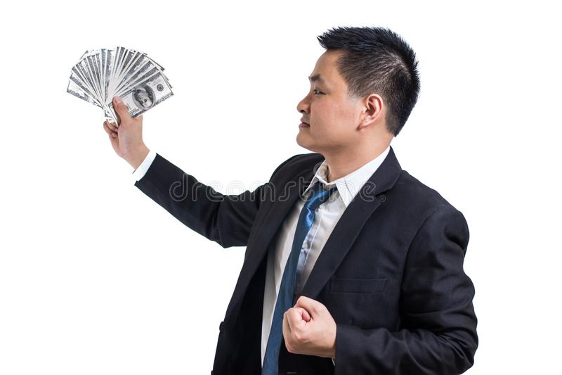 年轻亚洲商人庆祝成功 举行美元钞票愉快和微笑的商人 库存照片