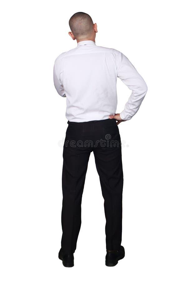 年轻亚洲商人想法的姿态,背面图 免版税库存照片