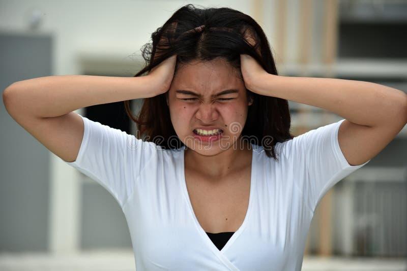 年轻亚裔女性和忧虑 免版税库存照片