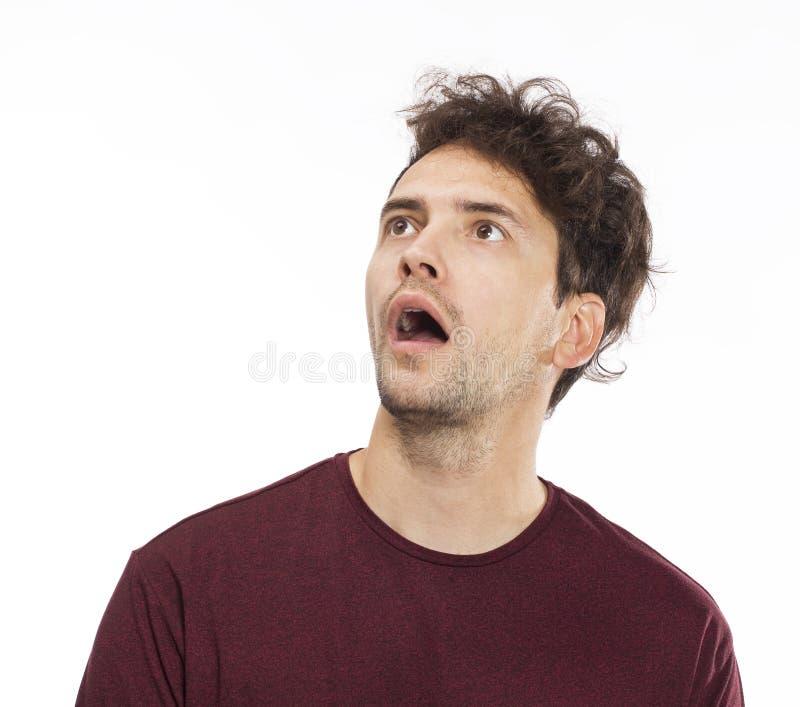 年轻人画象使有张的嘴的人惊奇 在空白背景 免版税库存照片