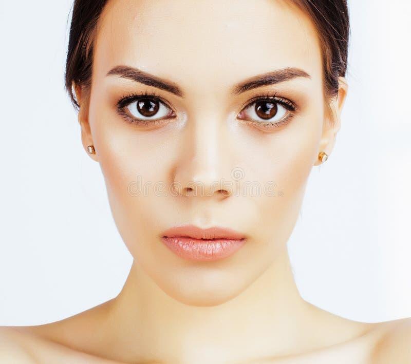 年轻人相当亚裔妇女用在白色ba隔绝的面孔的手 库存图片