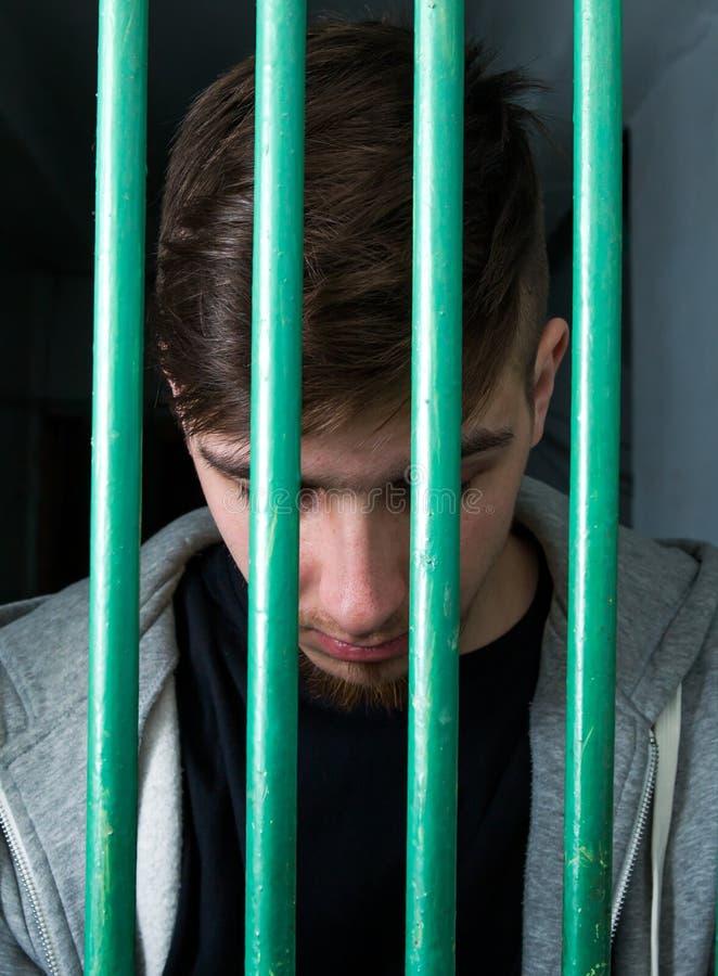 年轻人被拘留 免版税库存图片