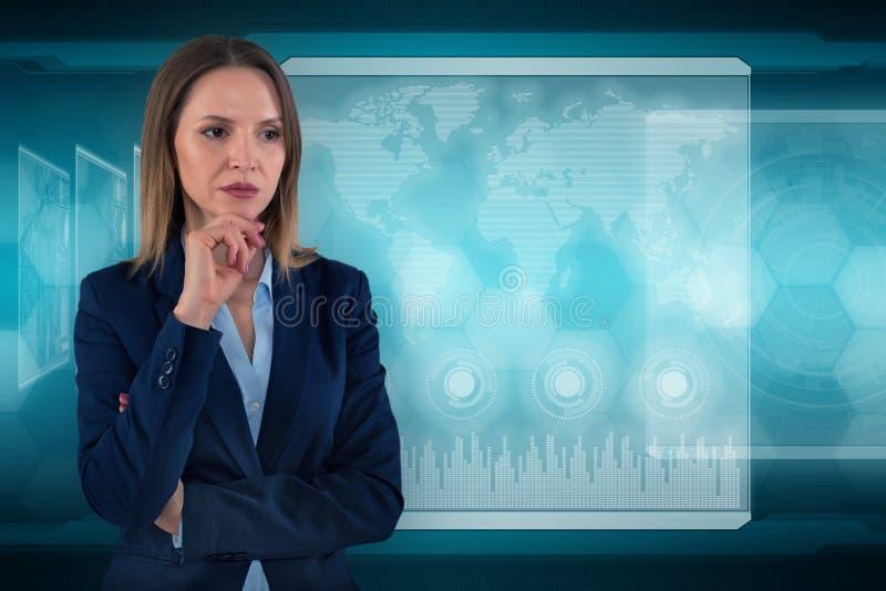 年轻企业夫人在未来派办公室 全球性公司概念 图库摄影