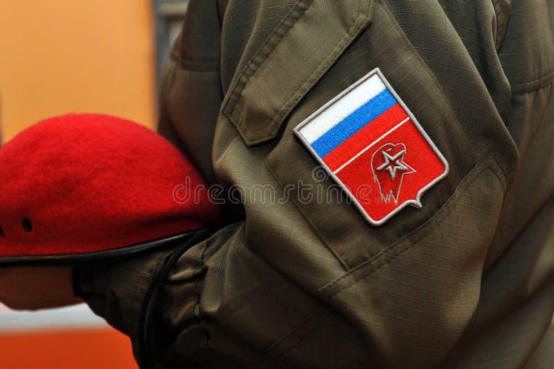 年轻军队V形臂章 关闭 库存图片