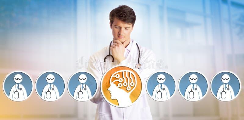 年轻医生在人的同事的Selecting AI 免版税库存照片