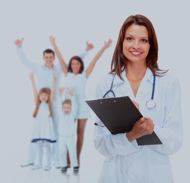 年轻可爱的女性在白色隔绝的医生和家庭 免版税库存图片