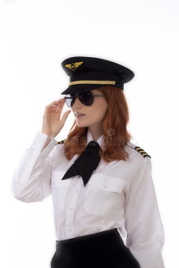 年轻可爱的女性航空公司飞行员 库存照片
