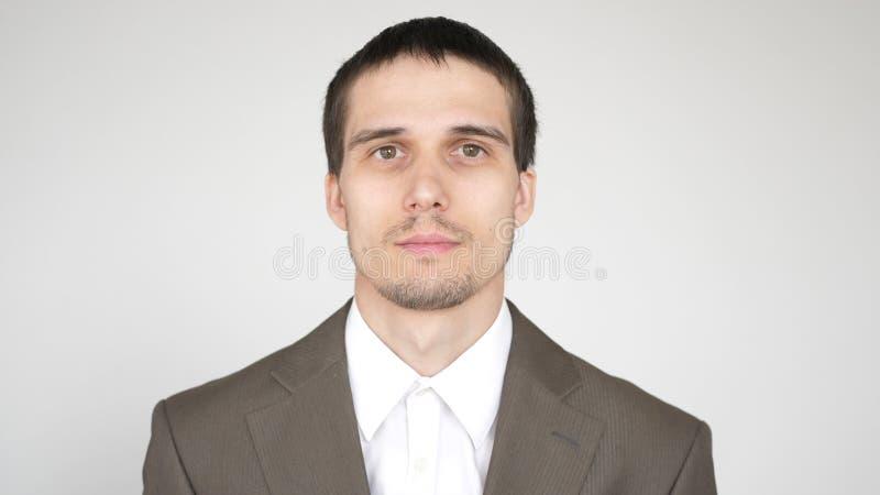 年轻可爱的成功的商人画象在白色背景的 库存图片