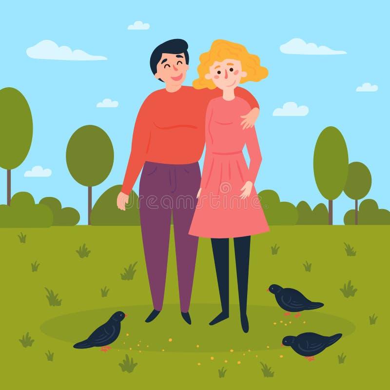 年轻夫妇在有鸽子的公园 皇族释放例证