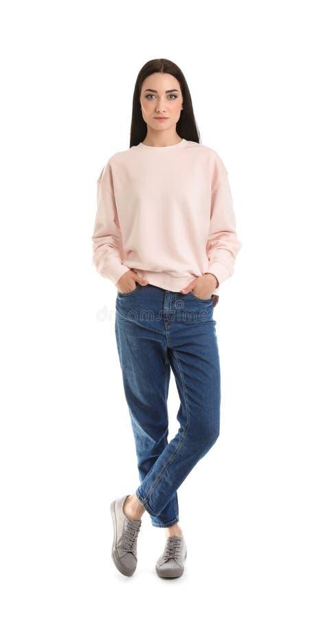 年轻女人全长画象在白色隔绝的毛线衣的 库存照片