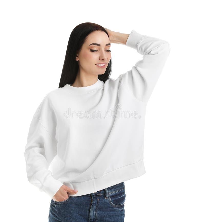年轻女人画象在白色隔绝的毛线衣的 免版税库存图片