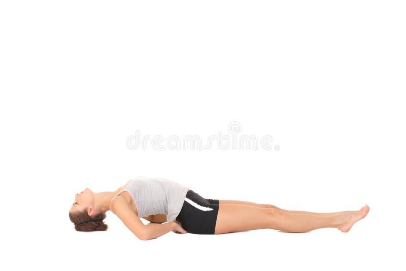 年轻女人训练瑜伽 库存图片