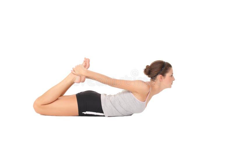 年轻女人训练瑜伽 库存照片