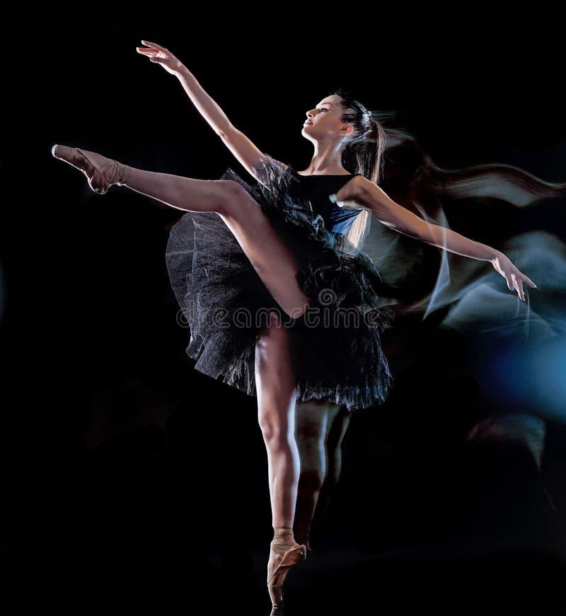 年轻女人跳舞黑背景光绘画的芭蕾舞女演员舞蹈家 免版税图库摄影