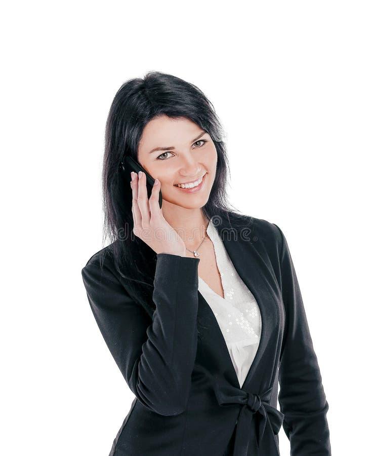 年轻女商人谈话在手机 库存照片