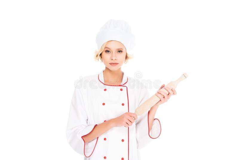 年轻女性厨师画象有滚针的在手上 免版税库存图片