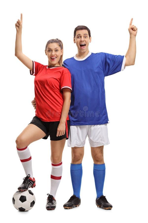年轻快乐的加上橄榄球在运动服举行穿戴了 库存图片