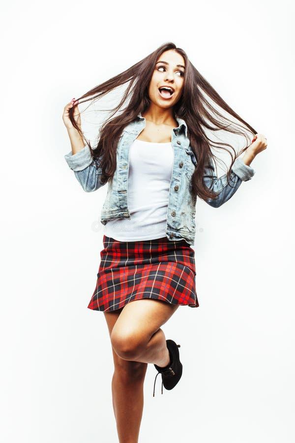 年轻愉快微笑的拉丁美洲十几岁的女孩情感摆在 免版税图库摄影