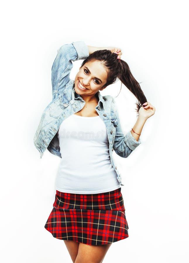 年轻愉快微笑的拉丁美洲十几岁的女孩情感摆在 免版税库存照片