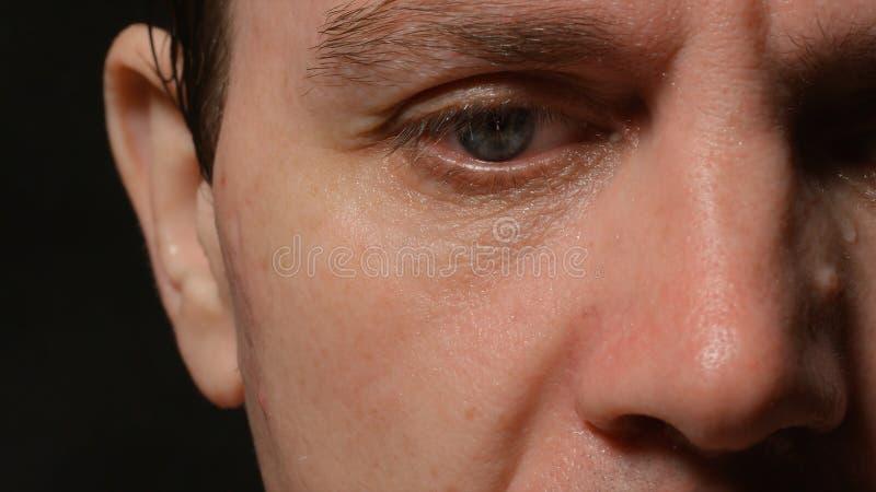 年轻成人人的哀伤的面孔 免版税库存图片