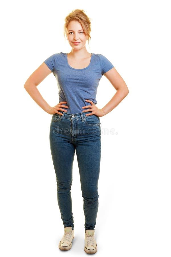 年轻白肤金发的妇女用在臀部的手 库存照片