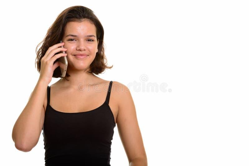 年轻美丽的白种人十几岁的女孩谈话在手机 库存图片