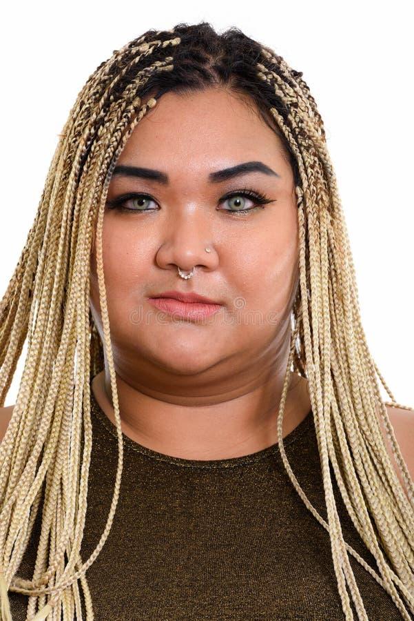 年轻肥胖亚裔妇女佩带的动物之鼻圈的面孔 库存图片