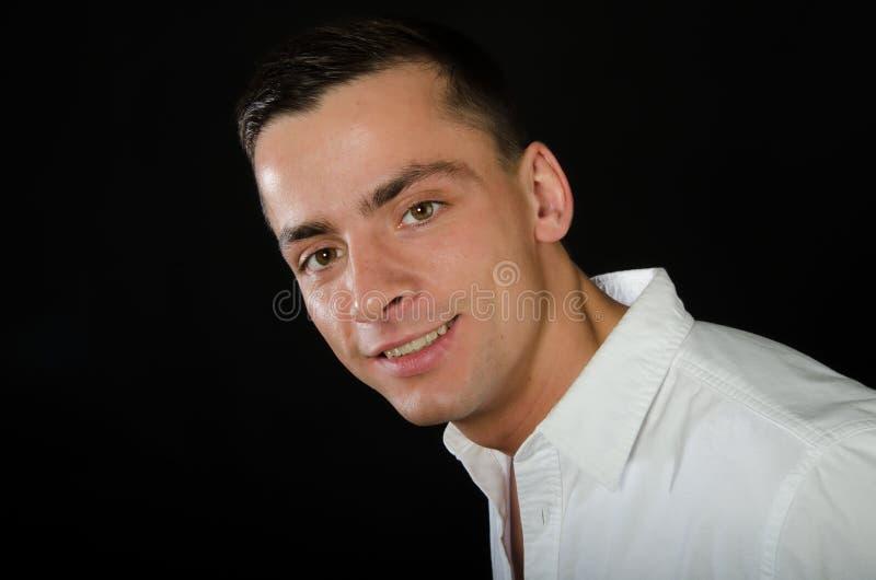 年轻英俊人微笑 事务和成功 免版税库存图片