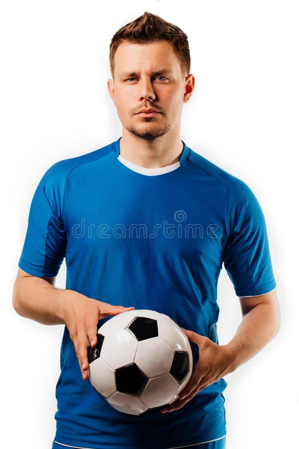 年轻英俊的足球运动员在手摆在白色的足球对负被隔绝 图库摄影