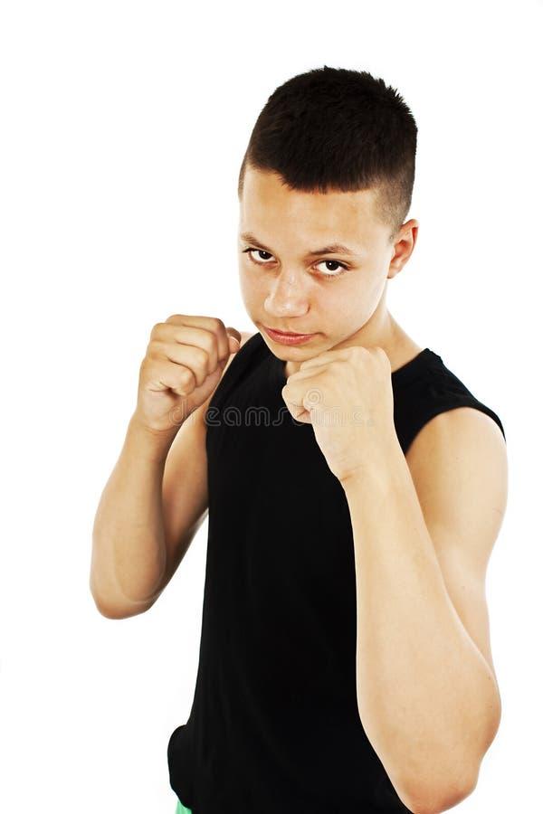 年轻被举的人恼怒的打手势的拳头 免版税库存照片