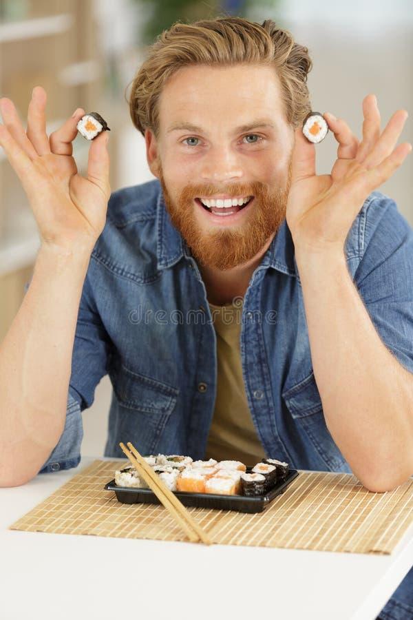 年轻食人的寿司 库存图片