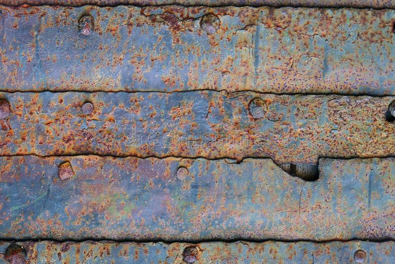 年迈的概略的金属板装甲纹理-相当抽象照片背景 图库摄影