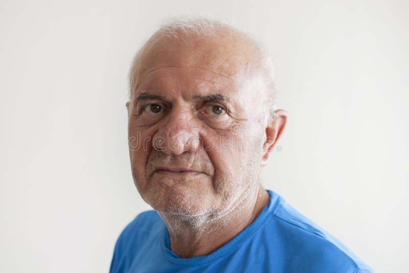 年长人面孔表示概念 库存图片