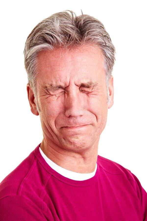 年长做鬼脸的人 免版税库存图片