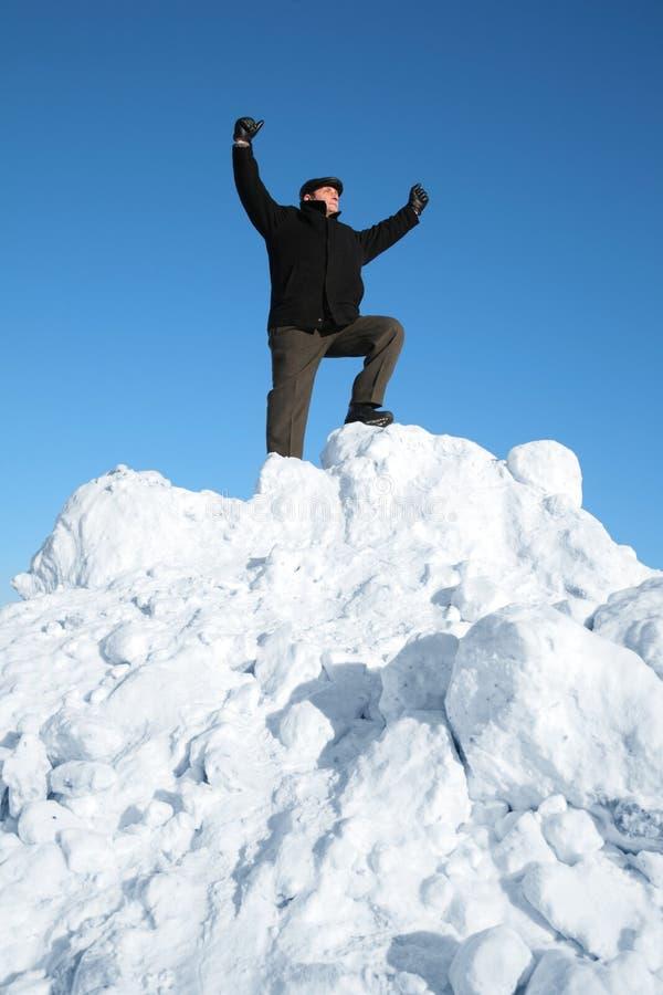 年长小山人雪顶层 库存照片