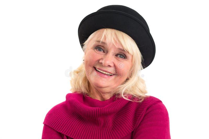 年长微笑的妇女 免版税库存图片