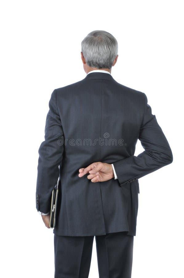 年龄生意人克服手指中间身分 免版税库存照片