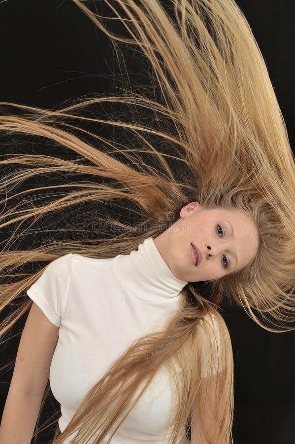 年龄白肤金发长期女孩头发性感青少&# 免版税库存照片