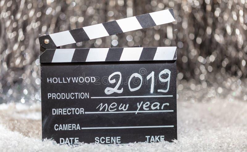 2019年,在电影拍板的新年,抽象bokeh光 库存照片