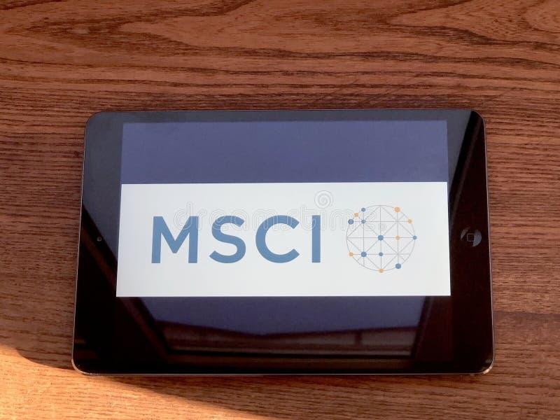 2019年12月,意大利帕尔马:MSCI公司标识图标平板电脑屏幕特写 MSCI视觉品牌 图库摄影