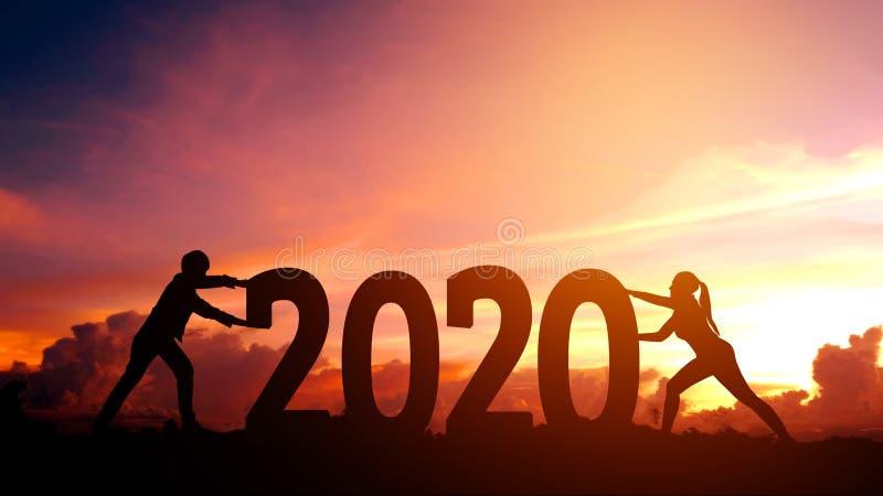 2020年Newyear推挤2020新年快乐概念的数字的夫妇尝试 免版税库存图片