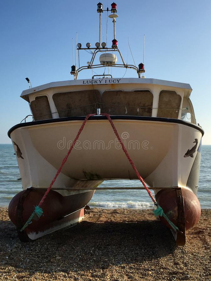 幸运的露西白色渔船 免版税库存照片