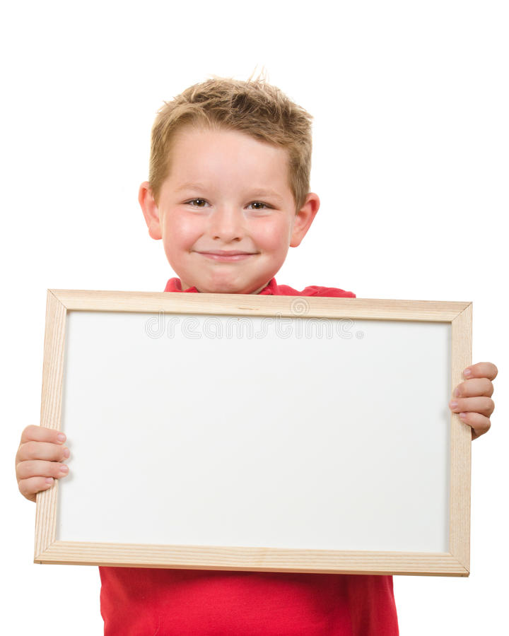 幼儿男孩画象拿着与室的空白的标志您的拷贝的 免版税库存图片
