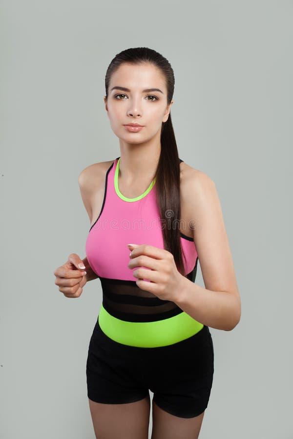 幼小运动的妇女慢跑者 健身,体育,训练 免版税库存照片