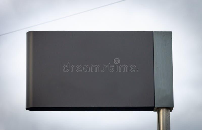 广告大模型路牌-灰色 免版税库存照片