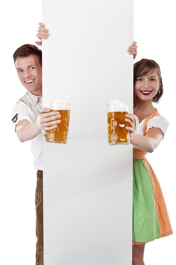 广告巴法力亚啤酒女孩人类空间啤酒&# 免版税库存图片